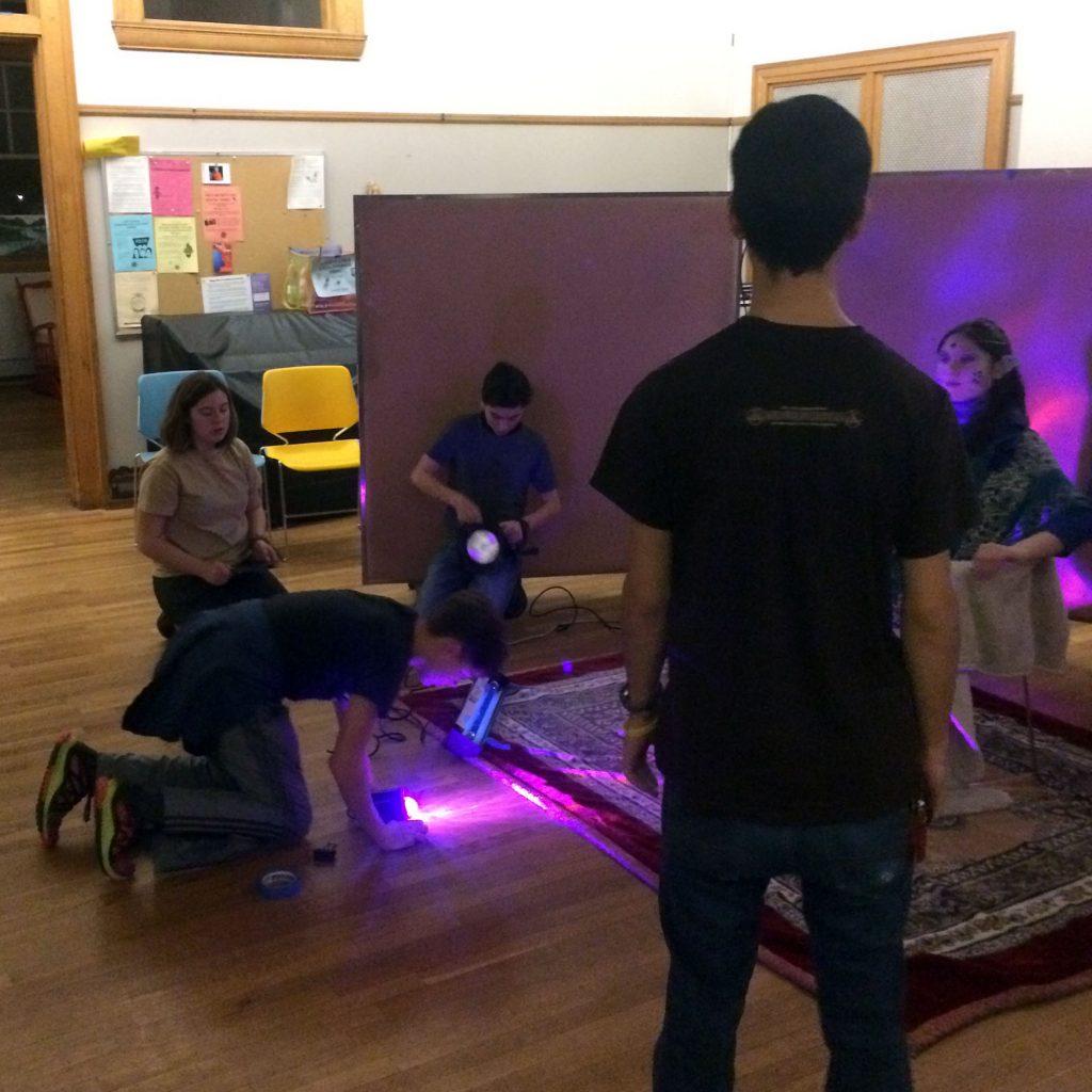 HS LARP students setting up lighting for a scene