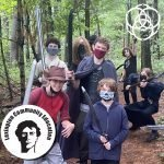LARP Students in costume on a path in the woods.